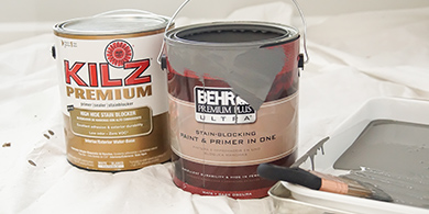 Gallon cans of BEHR PREMIUM PLUS ULTRA paint and KILZ Premium primer