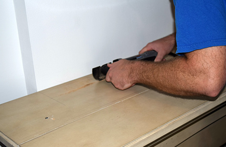 Cutting a notch in the top of the new wooden mantle