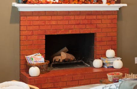 The original red brick fireplace