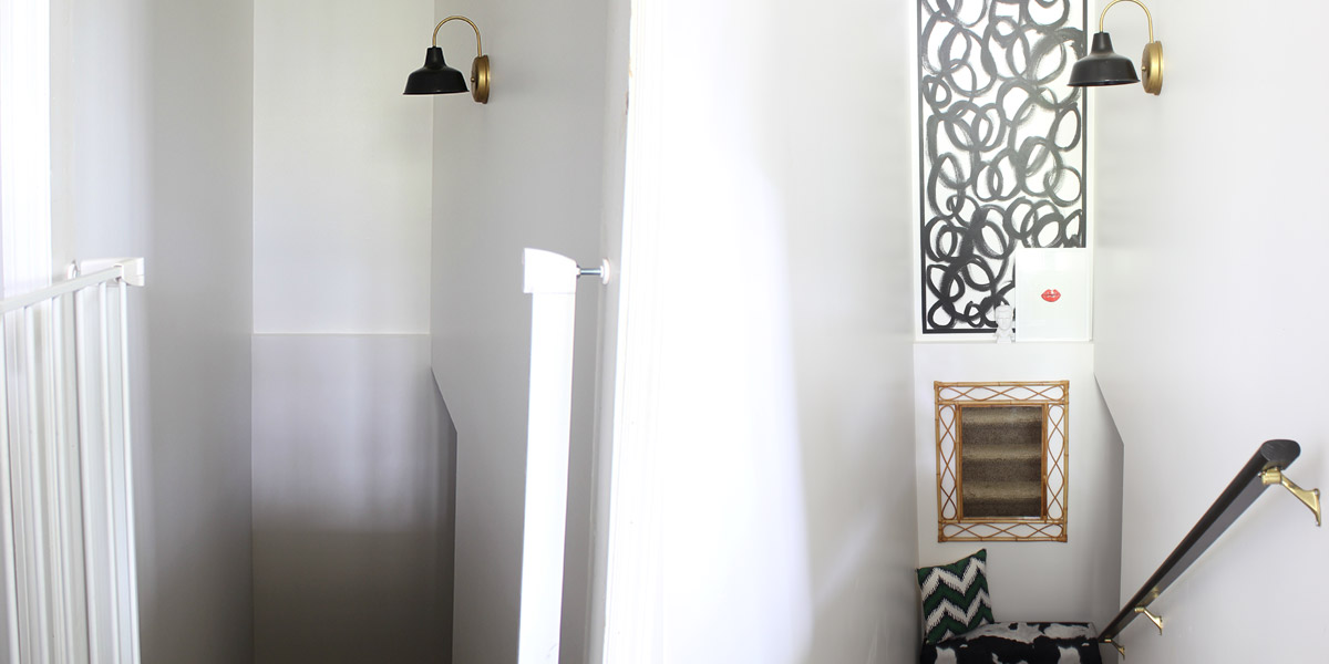 Before and after of stairwell wall with patterned design