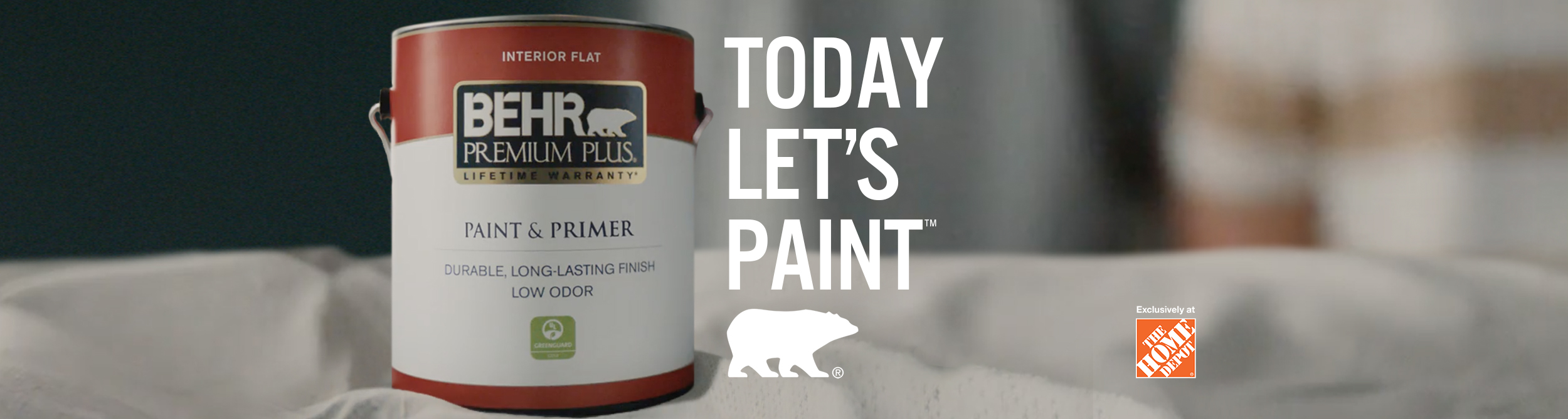 Person getting ready to paint with a can of BEHR Premium Plus Flat interior paint and the words Today Let's Paint in the foreground.