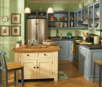 Kitchen with blue cabinets and green colored walls