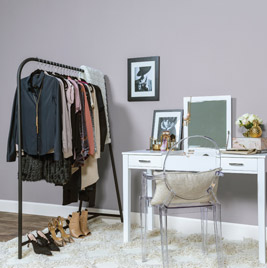 Desk with clothes hanging up