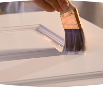 Person painting door trim