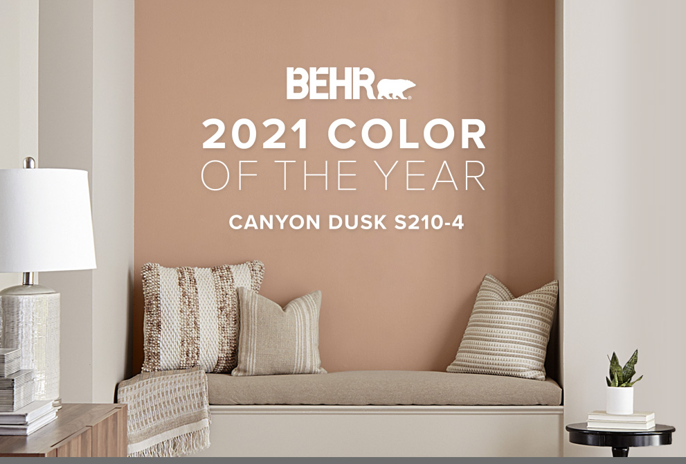 Tablet view of an image with the words BEHR 2021 Color of the Year is Canyon Dusk with the color in the background.