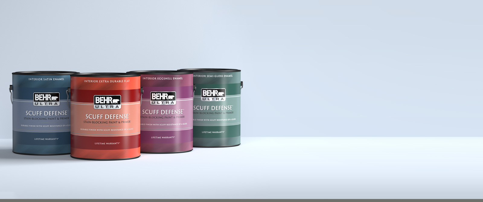 1 gallon can image of BEHR ULTRA SCUFF DEFENSE on a gray background.