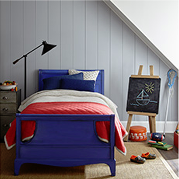 Kid's bedroom with blue bed and red comforter