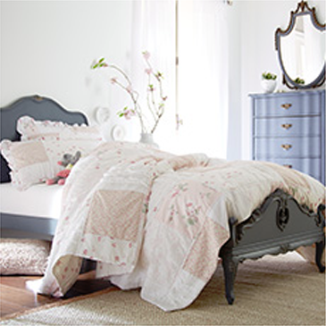 Gray bed with white comforter and matching dresser