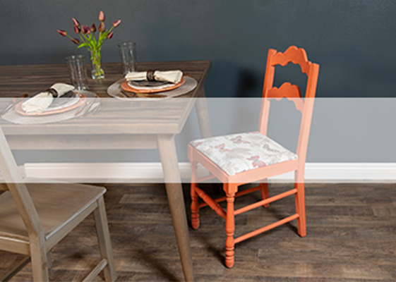 Table with one orange chair and one brown chair
