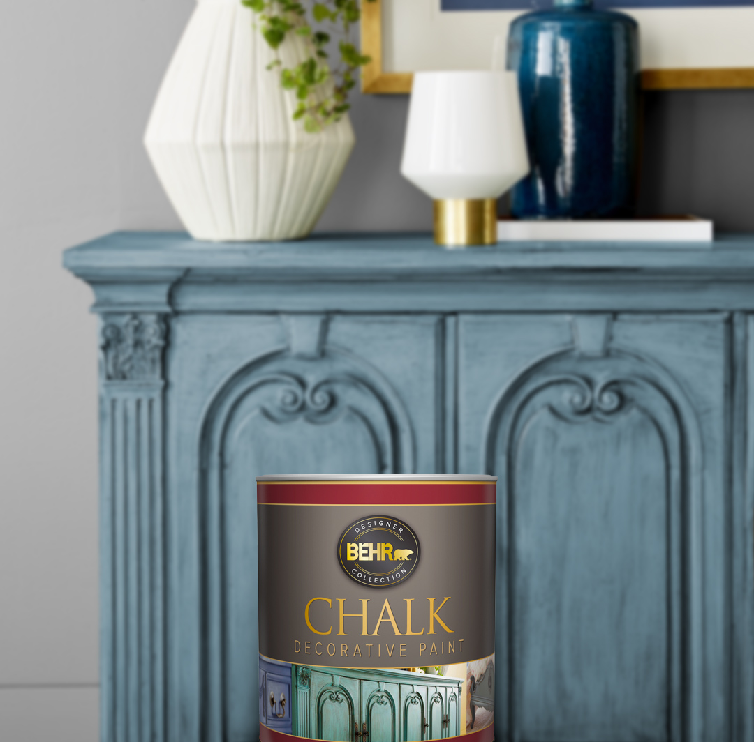 Can of Behr paint sitting in front of a blue cabinet, small image.