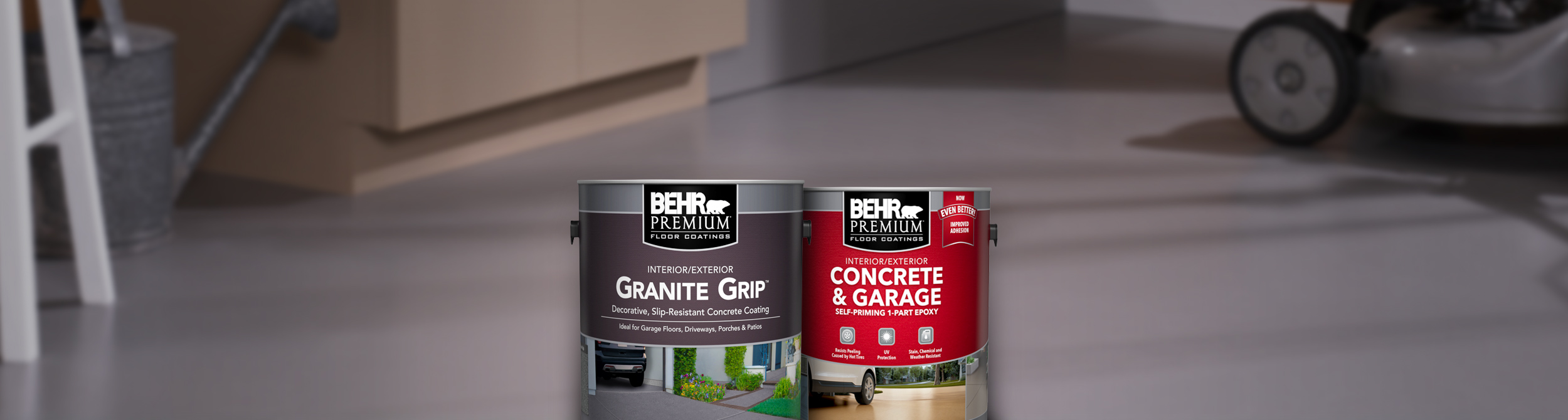 Two cans of Behr paint with garage floor in the background
