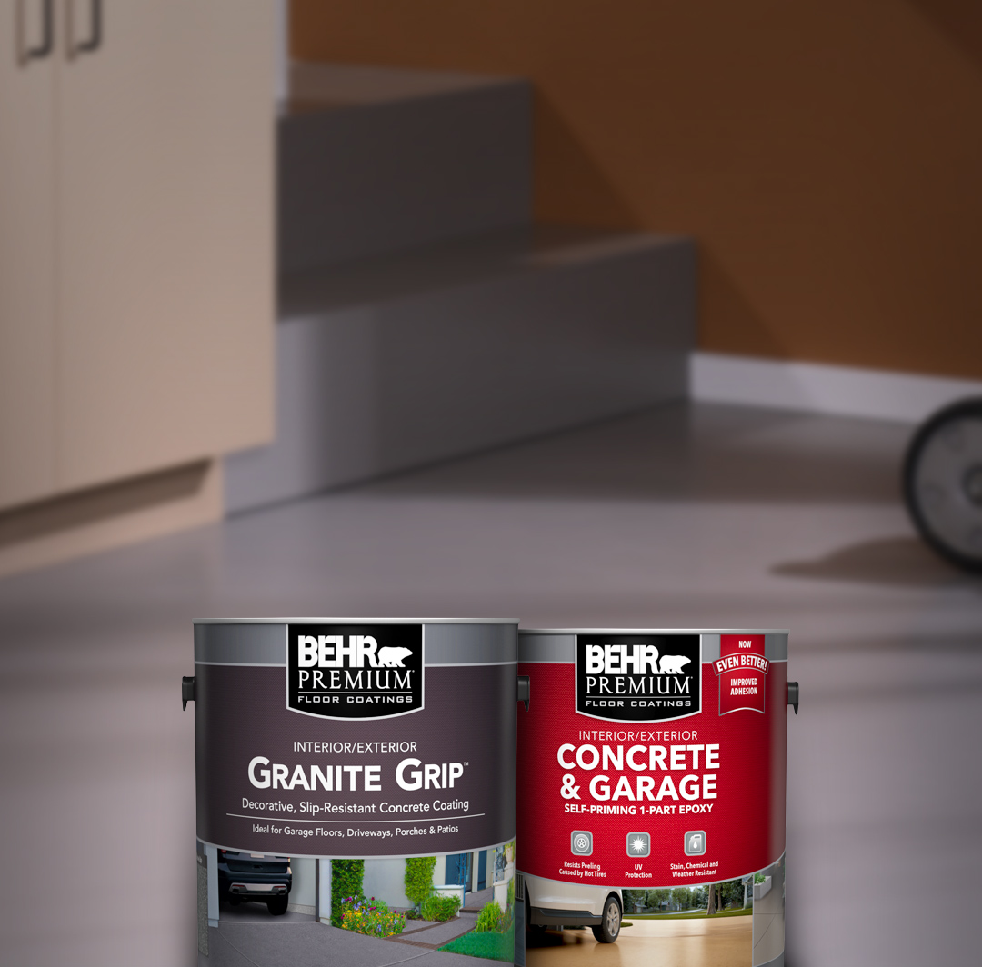 Two cans of Behr paint with garage floor in the background. For mobile.