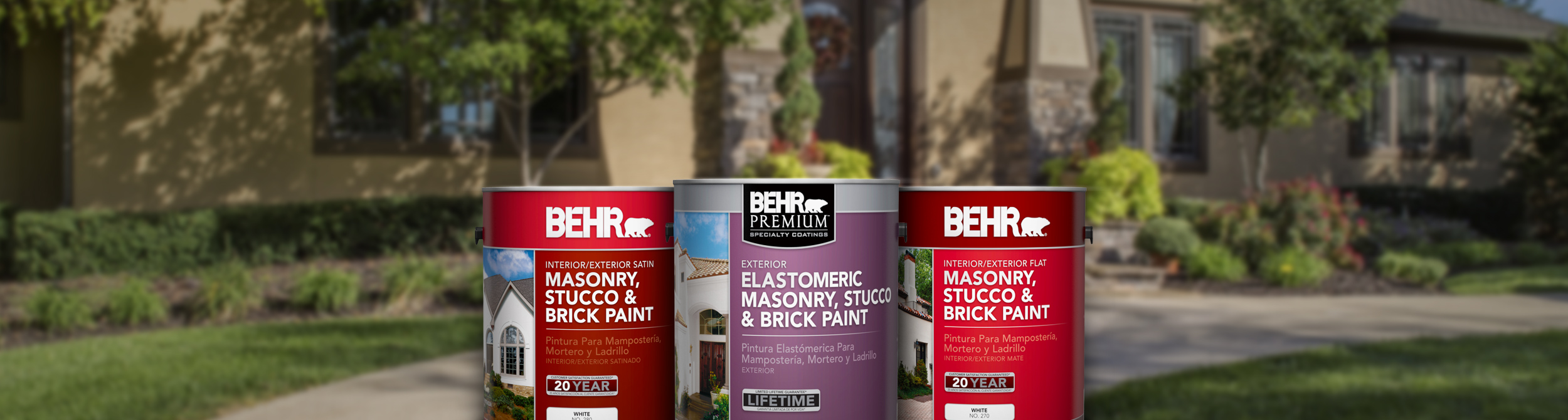 Three cans of Behr paint with large home and trees in the background