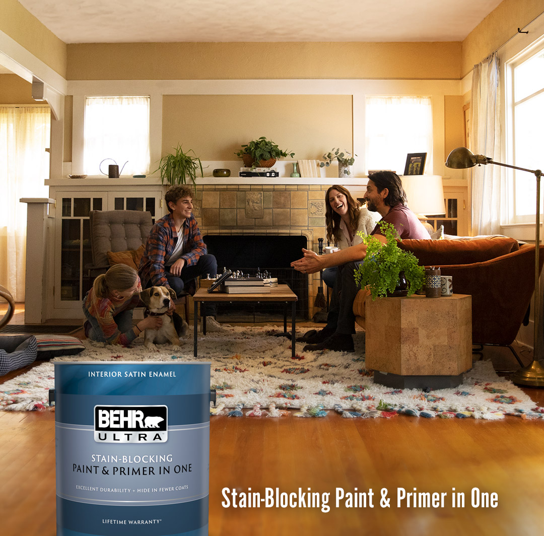 Mobile-sized image of family sitting in their family room.  Gallon cans of Ultra Interior Satin Enamel and Semi-
