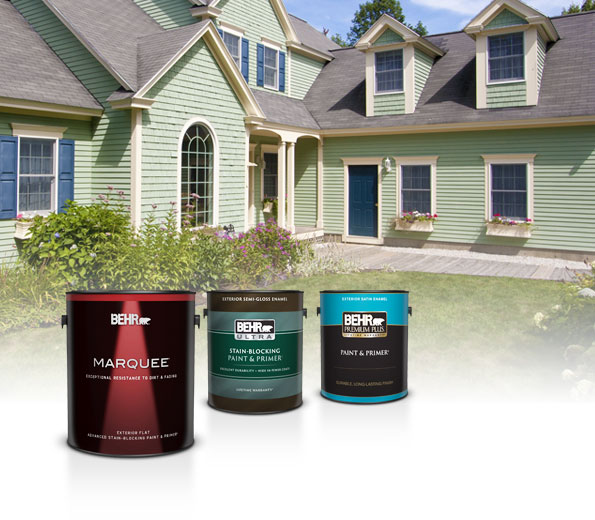 Three cans of Behr Exterior Paint with a pale green house in the background
